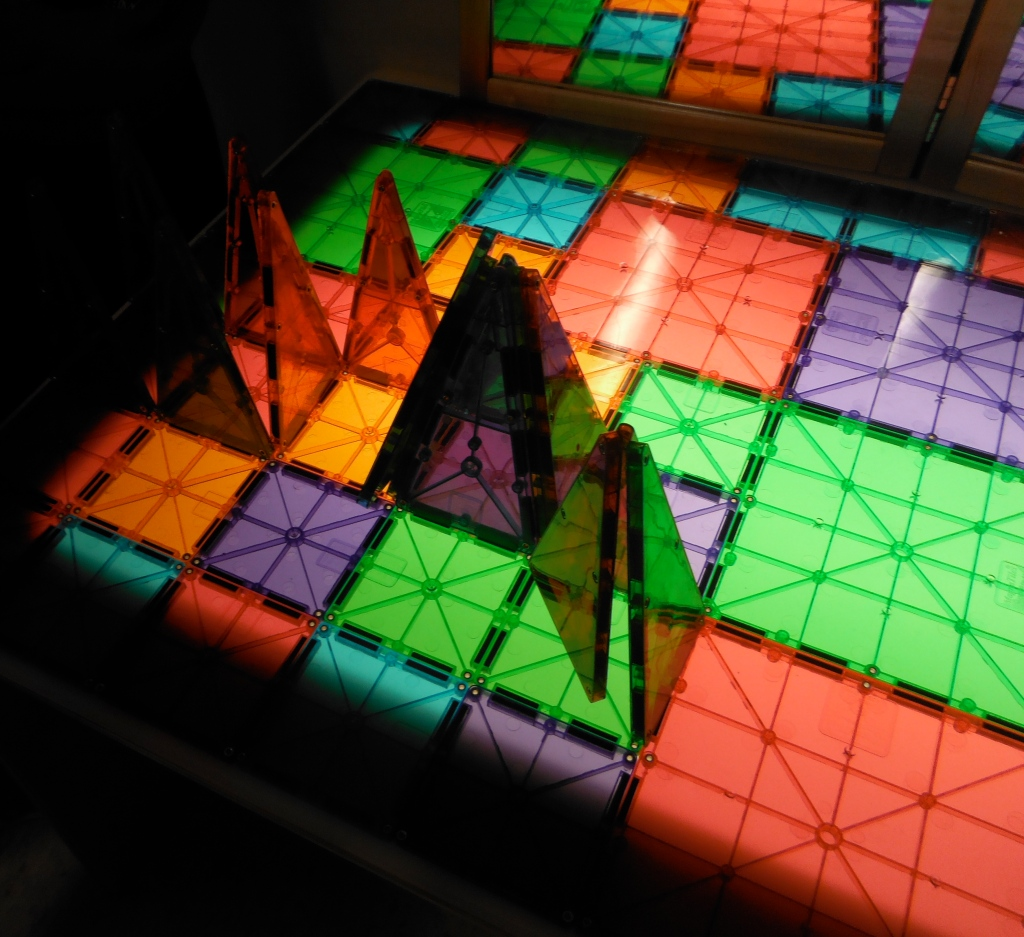 Covering the surface of the light table with tiles and using that as a building surface makes the whole project glow.