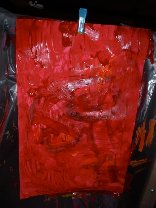 robot painting covered by red paint