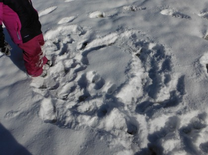 a child-created footprint in the snow.