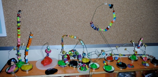 wire sculptures displayed on a shelf