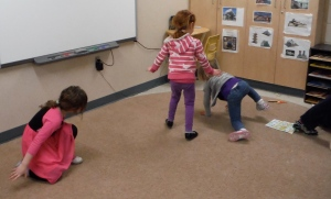 girls playing butterfly tag on the carpet