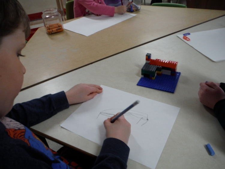 boy drawing his Lego building