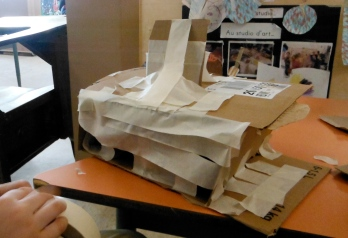 flat-roofed building with overhand made with cardboard and masking tape