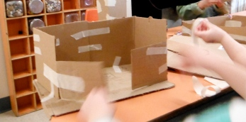cardboard building with double doors