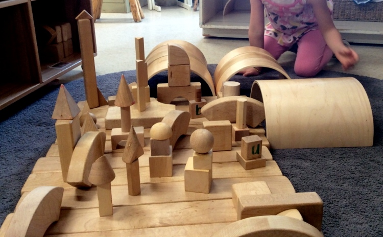 child's city constructed with wooden blocks