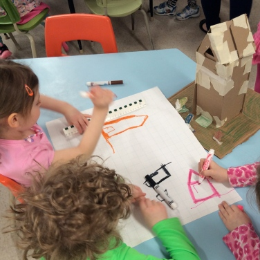 children drawing a model building