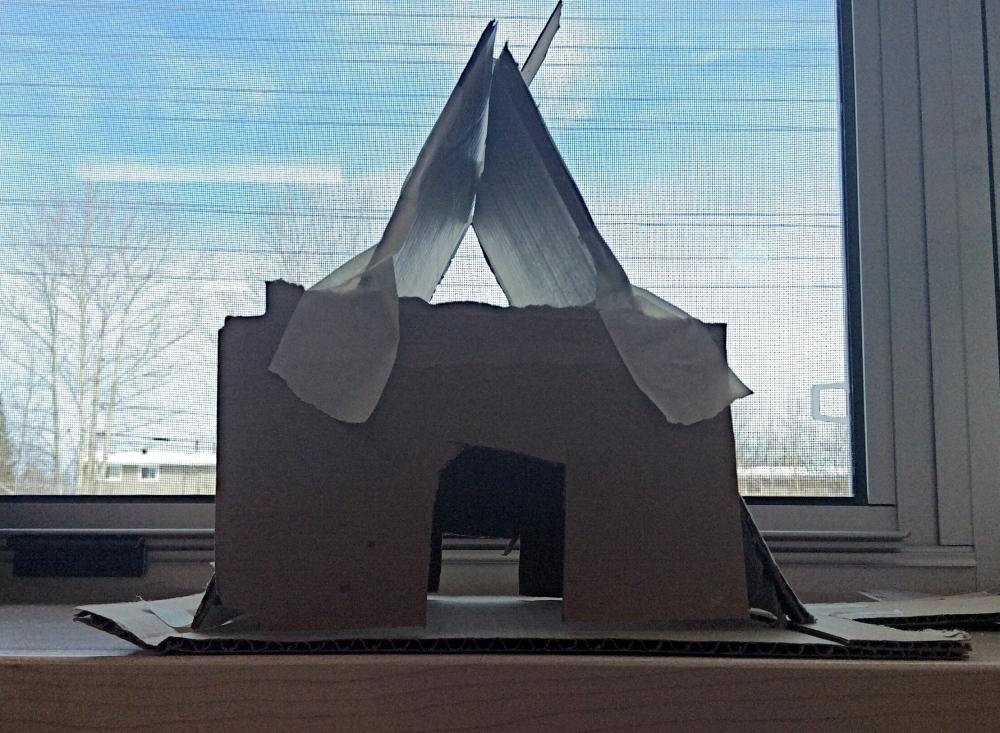 a-frame house built with cardboard