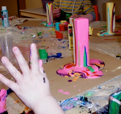 tall painting and child's hand
