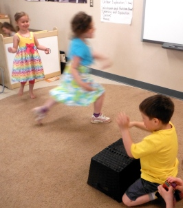 children dancing with drum accompaniment