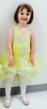 girl in yellow dance costume